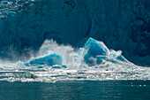A large chunk of ice crashes from Sawywer Glacier into water, Tracy Arm, Stephens Passage, Tongass National Forest, Tracy Arm-Fords Terror Wilderness, Alasksa, USA, North America