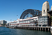 Walsh Bay with Pier One in front of the Harbour Bridge, Sydney, New South Wales, Australia
