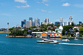 Colourful boat houses in Mort Bay with the city of Sydney in the background, Sydney, New South Wales, Australia
