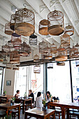 Chinese bird cages decorate the ceiling of the tea house at the White Rabbit Gallery in Chippendale, Sydney, New South Wales, Australia