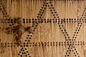 Wooden door with iron adornment in the Draa Valley, Morocco