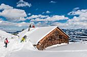 People on a snowshoe tour through a snowy landscape, Illertal, Hoernerdoerfer, Allgau, Baden-Wuerttemberg, Germany, Europe