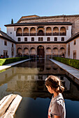 Child in the courtyard of the Alhambra, Granada, Andalusia, Spain, Europe