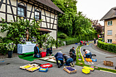 People arranging petals for the flower carpet, Corpus Christi, Feast of Corpus Christi, procession, Sipplingen, Lake Constance, Baden-Wuerttemberg, Germany, Europe