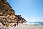 Children walking on the beach, Agia Galini, Crete, Greece, Europe