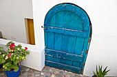 Blue door of a house in Plakias, Crete, Greece, Europe