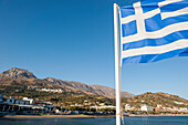 Greek flag at the coast, Plakias, Crete, Greece, Europe