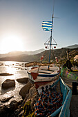 seafront in the evening with painted boat, Plakias, Crete, Greece, Europe