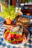 Greek food, tomato salad with fresh bread, Restaurant in Plakias, Crete, Greece, Europe