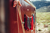 Clothes hanging in front of a red cabin in greenland, greenland, arctic.