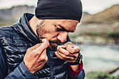 Man preparing a fishing line, greenland, arctic.