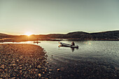 Men with a rowing boat in greenland, greenland, arctic.