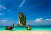 longtailboats and view to the huge rock in front of Koh Poda, Andaman sea, Krabi, Thailand