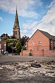 church tower, UK flag and burnt tarmac road, Belfast, Northern Ireland, United Kingdom, Europe