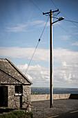 traditional Irish stone house and power pole, County Clare, Ireland, Europe