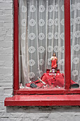 Jesus figure at window of a house in Sligo, County Sligo, Ireland, Wild Atlantic Way, Europe