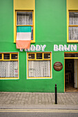 Irish flag at window of bar Paddy Bawn, green house, Dingle Town, Dingle Peninsula, Slea Head Drive, County Kerry, Ireland, Wild Atlantic Way, Europe