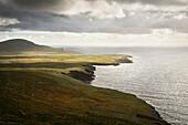 dramatic lit coastline at Bray Head, Bruff, Valentia Island, County Kerry, Ireland, Wild Atlantic Way, Europe