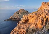 rocky coast at L'Ile Rousse, Corsica, France