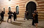 People dancing in the Palazzo della Regione at Piazza dei Signor, Verona, Venetian, Italy