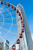 The Two International Finance Centre skyscraper with the big wheel The Hong Kong Observation Wheel, Hong Kong, China, Asia
