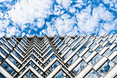 A high-rise building from a worm's eye view with a striking sky, Hong Kong, China, Asia