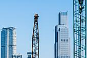 View of skyscrapers and cranes on Hong Kong Island, Hong Kong, China, Asia