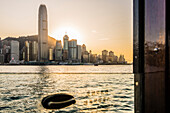 The skyline of Hong Kong Island seen trough the window of a Star Ferry ferry line during sunset, Hong Kong, China, Asia
