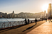 The promenade in Kowloon on Victoria Harbour with the skyline of Hong Kong Island, Hong Kong, China, Asia