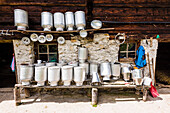 A cowshed with milk cans and tools in the sun, Ginzling, Zillertal, Tyrol, Austria