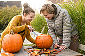 Children with pumpkin on Halloween, Hamburg, Germany