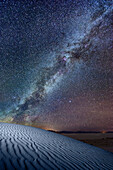 Nightsky with milkyway above white sand dunes, White Sands National Monument, New Mexico, USA