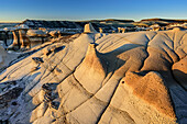 Brown and white striped rock formation with sandstone, Bisti Badlands, De-Nah-Zin Wilderness Area, New Mexico, USA