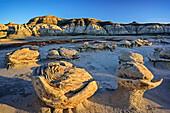 Striped rock eggs with sandstone, Bisti Badlands, De-Nah-Zin Wilderness Area, New Mexico, USA