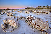 Striped rock eggs with sandstone at dawn, Bisti Badlands, De-Nah-Zin Wilderness Area, New Mexico, USA