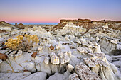 Rock towers with white sandstone at dawn, Bisti Badlands, De-Nah-Zin Wilderness Area, New Mexico, USA