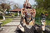 Barong statue in the Tirta Gangga water palace, a former royal palace. Karangasem regency, Bali, Indonesia.