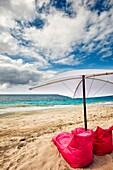 Bean bag chairs and umbrella for rent on White Sand Beach (Pantai Bias Putih). Manggis subdistrict, Karangasem Regency, Bali, Indonesia.