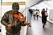 Paris, France. Mature adult male musician performing his music inside Chatalet Subway Station. Music in the French Underground system is wide spread, giving commuters an extra good experience during their commutes. And it provides an extra source of incom