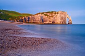 Etretat, Aval cliff , Falaise d'Aval, Natural Arch and Stone Beach, Normandy, Dawn, Seine Maritime, Upper Normandy, Haute Normandie, France.