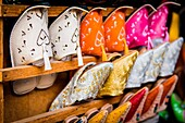 Fes, Marocco, North Africa. Detail of typical Moroccan colored shoes.