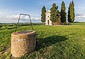 Madonna di Vitaleta chapel and its well, San Quirico d'Orcia. Orcia Valley, Siena district, Tuscany, Italy.