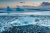 Block of ice on the black beach in Jokulsarlon Glacier Lagoon, Eastern Iceland, Europe.