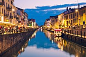 Milan, Lombardy, Italy. The Big Naviglio at dusk.