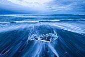 Jokulsarlon, southern Iceland. Iceberg on the black sand beach.