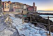 Spring sunset on the rock walk at Tellaro, Lerici, La Spezia gulf, Liguria, Italy.