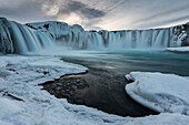 Gullfoss waterfall in norther Iceland near Akureyri after the sunset, during the blue hour in a cold winter evening.