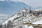 Church of San Atonio Abate and Castel Grumello in winter. Montagna, Valtellina, Lombardy, Italy Europe.