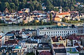 Top view of the typical buildings and houses set among green hills and river Passau Lower Bavaria Germany Europe.