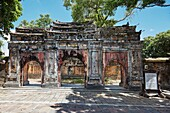 Gate to the ruined Phung Tien Temple. Imperial City (The Citadel), Hue, Vietnam.